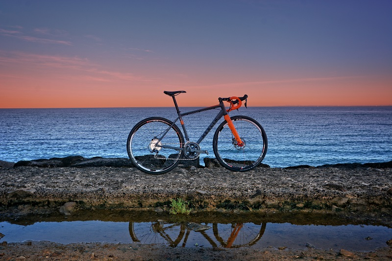 Picture of a Merlin Cycles Malt G bike against a sunset